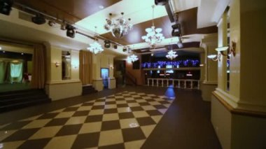 Hall with checkered floor in restaurant — Stockvideo