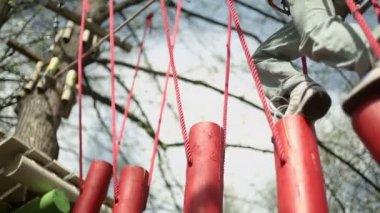 Young boy walks by log bridge — Stock Video