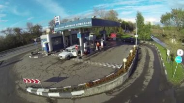 Blue car stopped for refueling at gas station — Stock Video