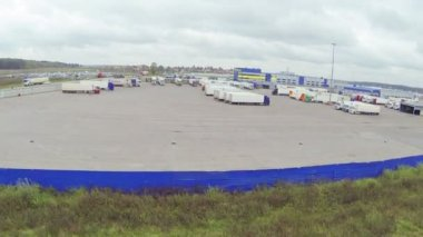 Trucks in big parking lot — Stockvideo
