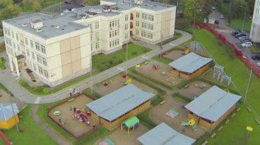 Kindergarten on playground above view — Stock Video