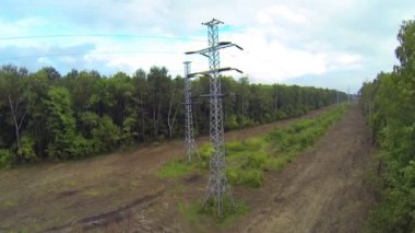 Line of power transmission towers — Stock Video