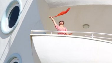 Girl waving kerchief on balcony — Stock Video