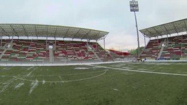 Empty tribunes near field on football stadium — Wideo stockowe