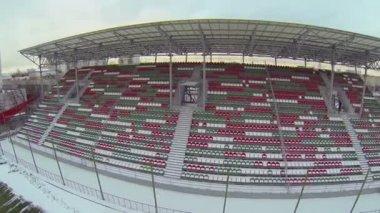 Empty tribunes of football stadium in winter — Stockvideo