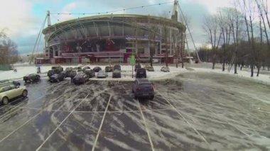 Football stadium Locomotive with cars on parking — Stock Video