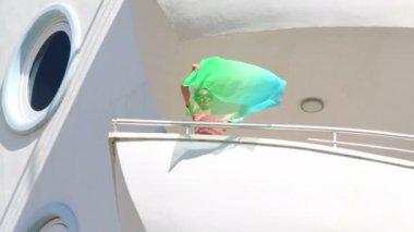 Girl on balcony waving kerchief — Stock Video