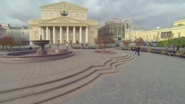 Girl walk  on square near edifice of Bolshoy Theater — Stock Video