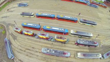 Several type of trams in city depot, above view — Stock Video