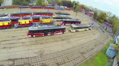 Day view: many tramway models parked in depot, aerial view — ストックビデオ