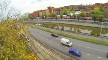 Tram leaving depot near river during the day, aerial view — Stock Video