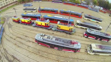 Tram depot plateau with many tram models, above view — Stock video