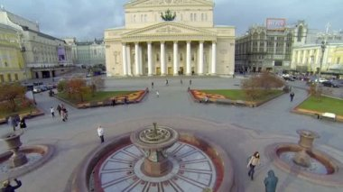 People walk by square near edifice of Bolshoy Theater — Stock Video