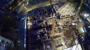 Builders work at construction site of dwelling complex — Stock Video