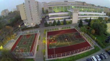 Students play basketball and soccer on playground — Stock Video