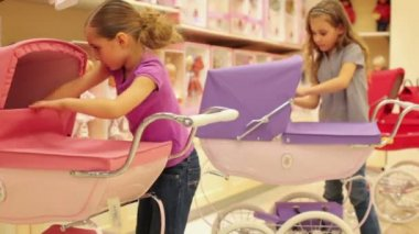 Girls dolls placed in stroller — Stock Video