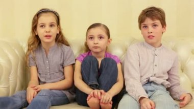 Two smiling young girls and boy — Stockvideo