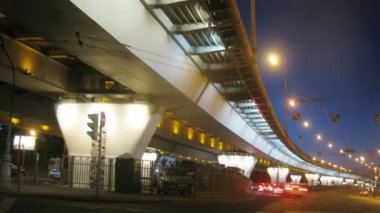 Traffic under illuminated bridge — Stock Video