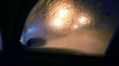 Male hand breaks ice on window — Stock Video