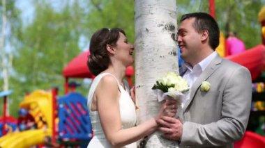 Newly married couple near birch — Stock Video