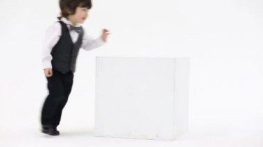 Little handsome boy runs around — Stock Video