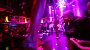 Go-go girl dances at pole on bar — Stock Video