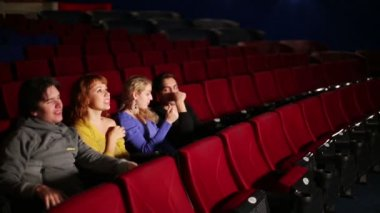 Four people in cinema watching film — Stock Video