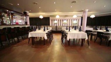Bar and tables in restaurant of Neva cinema — Stockvideo