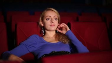 Young cute girl seats in cinema — Stock Video
