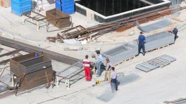 Workers talk near residential complex — 图库视频影像