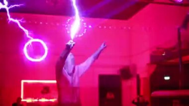 Performers with artificial lightning at presentation — Stock Video