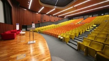 Stage with sofas in modern auditorium — Stock Video