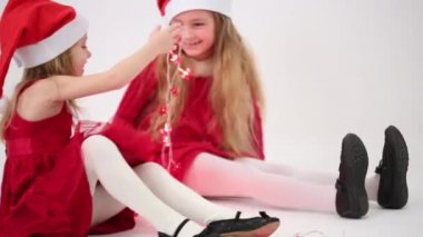 Two girls with caps Santa Claus — Stock Video