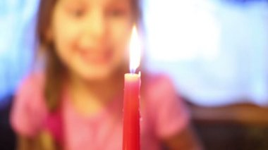 Little girl blows out candle — Stock Video