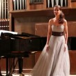 Woman pianist plays piano and singer — Stock Video #75456419
