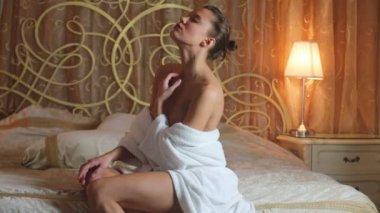Beautiful naked girl in white robe — Stock Video