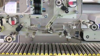 Moving metal conveyor of industrial machine — Stock Video