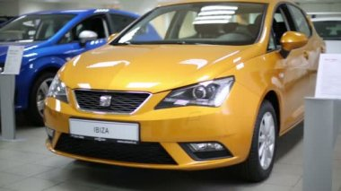 Commercially colourful shining cars in dealership — Stock Video