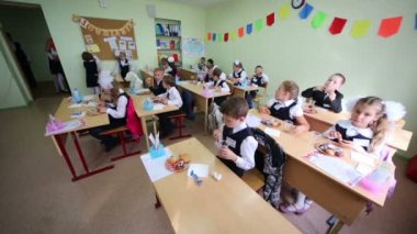 First grade pupils sit at desks — Stock Video