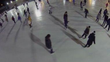 People slide by skating rink — Stock Video