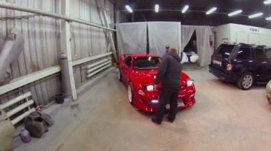 Man opens bonnet of sport car — Stock Video