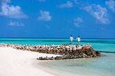 Couple at tropical beach — Stock Photo