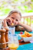 Little girl eating — Stock Photo