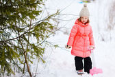 Little girl outdoors at winter — Stock Photo
