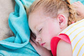 Adorable little girl at beach sleeping — Stock Photo