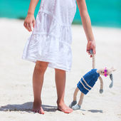 Little girl with toy at beach — Stockfoto