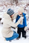 Mother and daughter outdoors on winter — Stock Photo