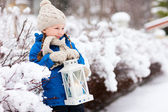 Little girl with Christmas lantern — Stock Photo