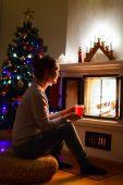 Young woman on Christmas eve — Stock Photo