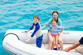 Family in inflatable dinghy boat — Stock Photo